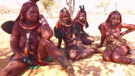 Himba-tribal-women-show-off-their-mud-hair-extensions-and-unusual-braided-dreadlocked-hairstyles-2
