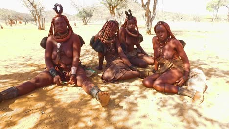 Himba-tribal-women-show-off-their-mud-hair-extensions-and-unusual-braided-dreadlocked-hairstyles-3
