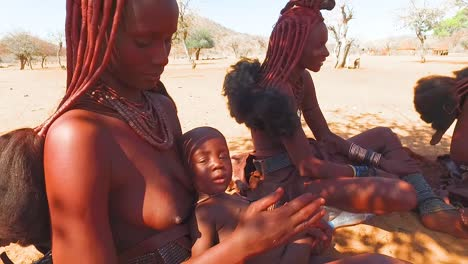 Himba-tribal-women-with-babies-show-off-their-mud-hair-extensions-and-unusual-braided-dreadlocked-hairstyles