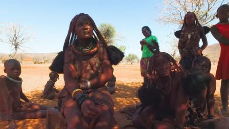 Himba-tribal-women-with-babies-show-off-their-mud-hair-extensions-and-unusual-braided-dreadlocked-hairstyles-2