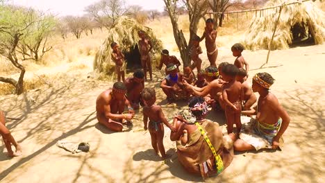African-San-tribal-bushmen-family-at-their-huts-in-a-small-primitive-village-in-Namibia-Africa-1