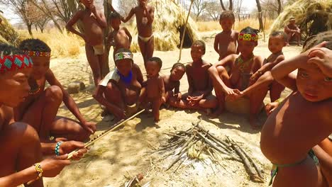 African-San-tribal-bushmen-family-at-their-huts-in-a-small-primitive-village-in-Namibia-Africa-2