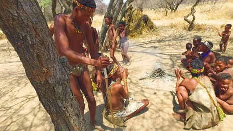 African-San-tribal-bushmen-perform-a-fire-dance-in-a-small-primitive-village-in-Namibia-Africa-1