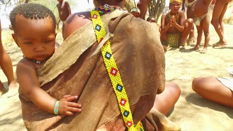 African-San-tribal-bushmen-perform-a-fire-dance-in-a-small-primitive-village-in-Namibia-Africa-3