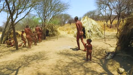 African-San-tribal-bushmen-perform-a-fire-dance-in-a-small-primitive-village-in-Namibia-Africa-4