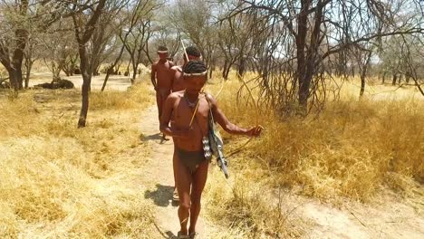 San-tribal-bushman-hunters-in-Namibia-Africa-walk-quiety-sniff-the-air-and-sample-the-soil-for-wind-direction-hunting-for-prey-1