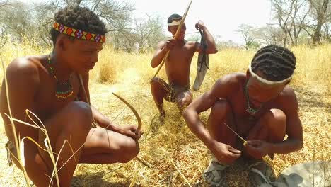 San-tribal-bushman-hunters-in-Namibia-Africa-walk-quiety-sniff-the-air-and-sample-the-soil-for-wind-direction-hunting-for-prey-2