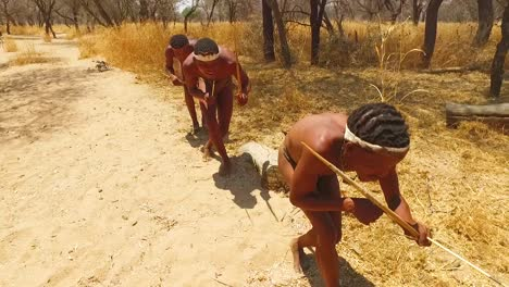 San-tribal-bushman-hunters-in-Namibia-Africa-walk-quiety-sniff-the-air-and-sample-the-soil-for-wind-direction-hunting-for-prey-8