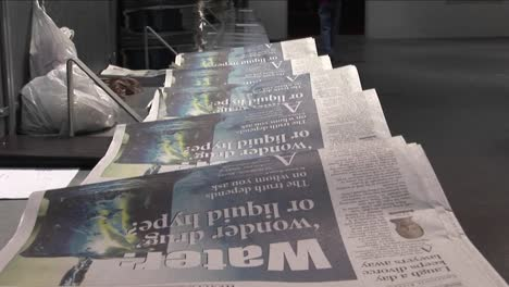 Tilt-up-to-the-Arts-and-Living-section-of-newspapers-in-the-factory