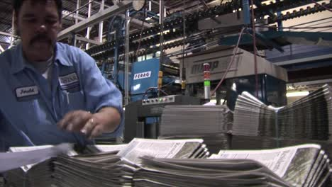 A-worker-stacks-newspapers-in-the-factory