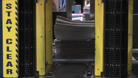 A-machine-stacks-and-binds-newspapers-in-a-factory