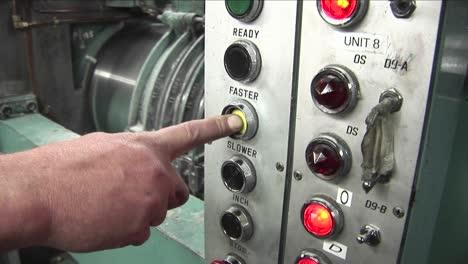 A-man-presses-a-machine-to-make-it-go-faster