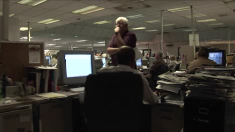 A-point-of-view-shot-walking-through-a-newsroom