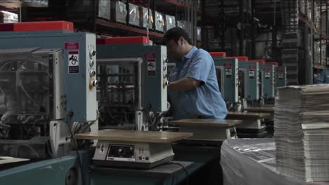 Workers-in-a-newspaper-factory-maintain-the-printing-presses