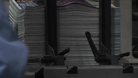 Magazine-supplements-are-stacked-in-a-newspaper-factory
