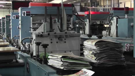 Workers-man-the-printing-presses-in-a-newspaper-factory