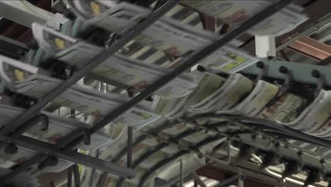 Newspapers-flow-along-an-assembly-line-in-a-newspaper-factory-3