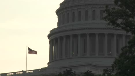 Pull-back-from-the-Capitol-Building-in-Washington-DC-with-an-American-flag-visible