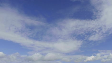 Time-lapse-of-clouds-against-blue-sky-moving-away