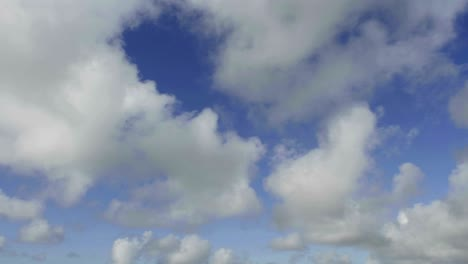 Time-lapse-of-clouds-against-blue-sky-moving-forward-3