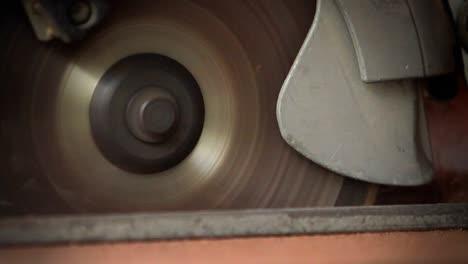 A-circular-saw-cutting-through-wood-at-a-workbench