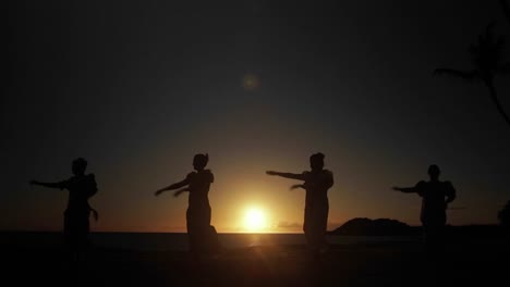 Native-Hawaiian-dancers-perform-in-the-distance-at-sunset-1