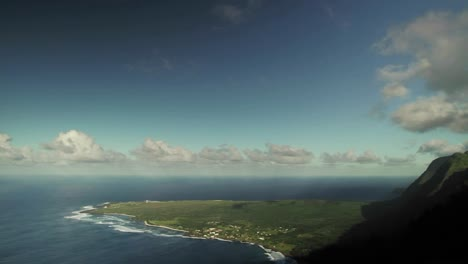 Time-lapse-of-clouds-over-a-mountaintop-and-beach-on-a-tropical-island