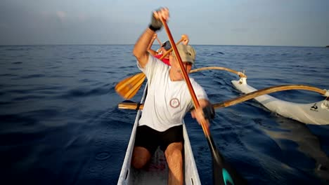 People-row-an-outrigger-canoe