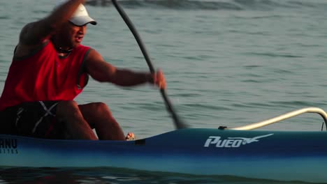 A-man-rows-an-outrigger-canoe-fast-
