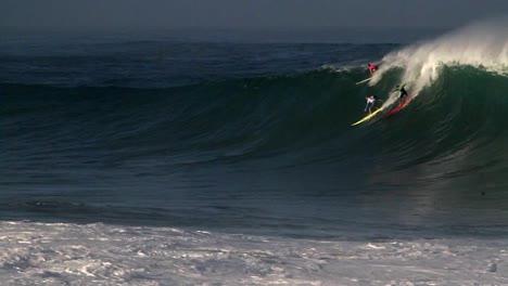 Multiple-surfers-ride-very-big-waves-in-Hawaii-1