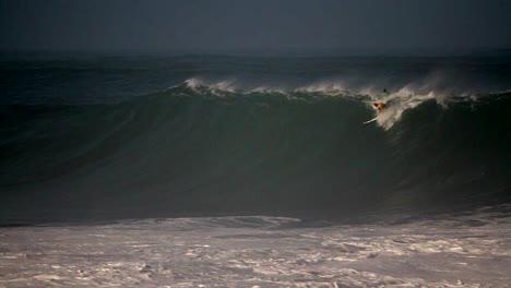 Multiple-surfers-ride-very-big-waves-in-Hawaii-4