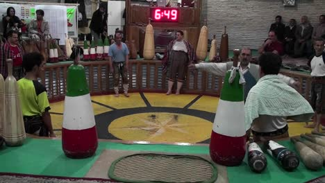 A-man-spinning-in-a-circle-demonstrates-the-traditional-Iranian-martial-art-of-Pahlavani