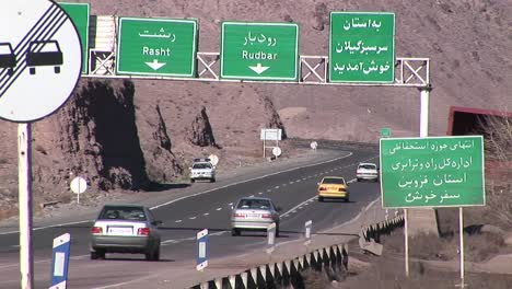 Cars-pass-along-a-highway-in-Iran