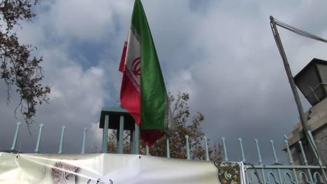 The-Iranian-flag-flies-atop-a-gate