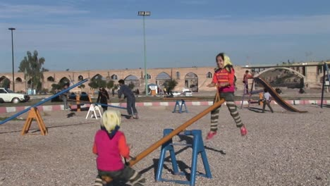Children-play-on-a-seesaw-in-Iran-1