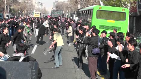 Protesters-march-down-a-busy-street-in-Iran-2