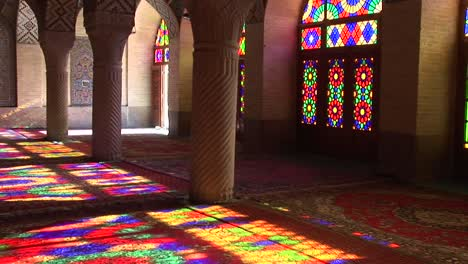 Sun-shines-through-stained-glass-windows-inside-the-Nasir-Molk-Mosque-in-Shriaz-Iran-