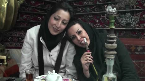 Women-in-headscarfs-smoke-a-hookah-pipe-in-a-cafe-in-Iran-1
