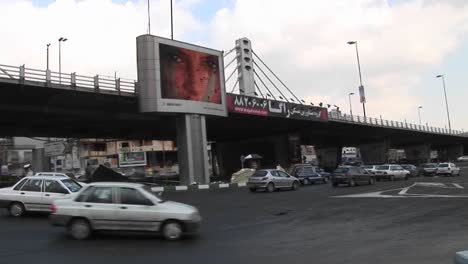 A-busy-thoroughfare-in-a-city-in-Iran-with-a-modern-digital-billboard-