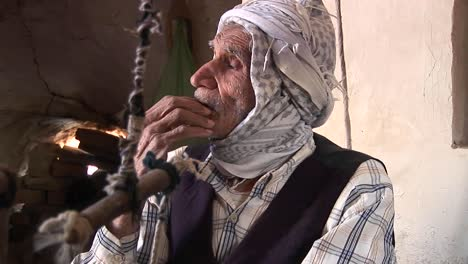 An-elderly-man-wearing-a-keffiyah-speaks-in-Iran-
