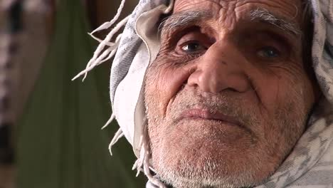 An-elderly-man-wearing-a-keffiyah-speaks-in-Iran-1