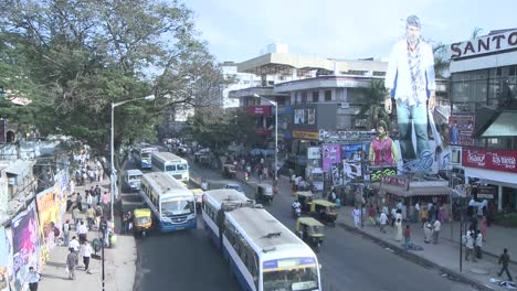 Time-lapse-view-of-traffic-and-pedestrians-traveling-down-a-busy-street