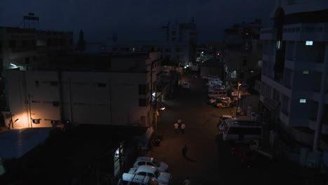Activity-in-the-parking-area-between-two-apartment-buildings-is-shown-in-time-lapse-from-night-until-morning