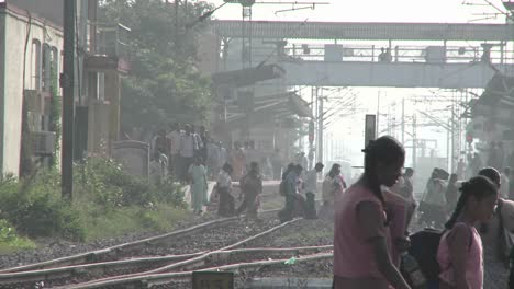 People-walk-back-and-forth-across-railroad-tracks