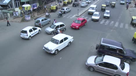 Vehicles-and-motorbikes-pass-through-a-busy-intersection-that-has-no-directional-signals