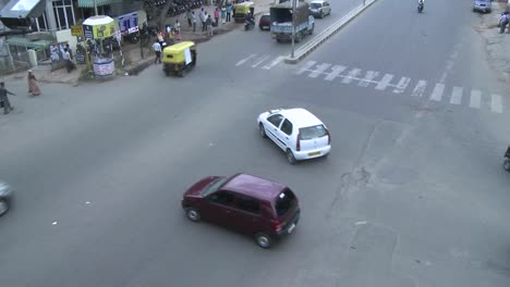 Traffic-in-a-busy-intersection-in-a-city-in-India-goes-by-in-time-lapse
