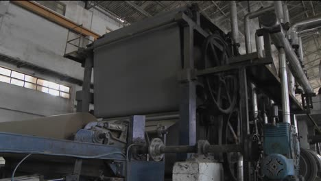 Mechanized-wheels-inside-of-a-factory-are-turning