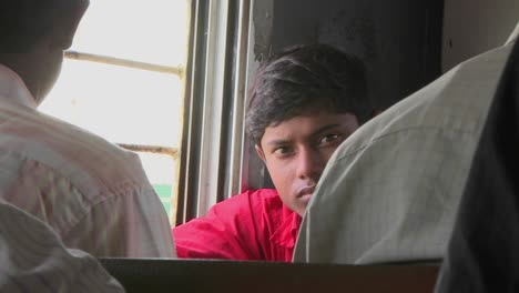 A-young-man-rides-on-a-train-in-India-