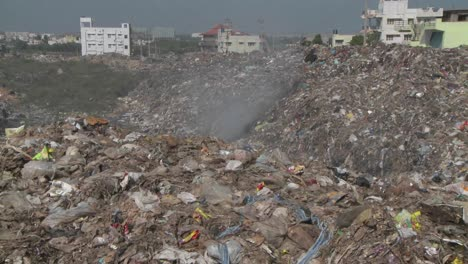 Smoke-rises-from-burning-rubbish-in-a-large-urban-landfill