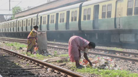 Women-set-fire-to-small-rubbish-piles-close-by-railroad-tracks